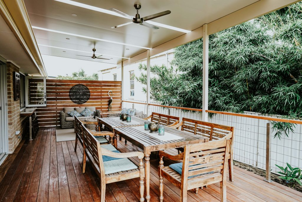 Locspec Building Oak Flats Renovation - wooden deck, dining table and chairs